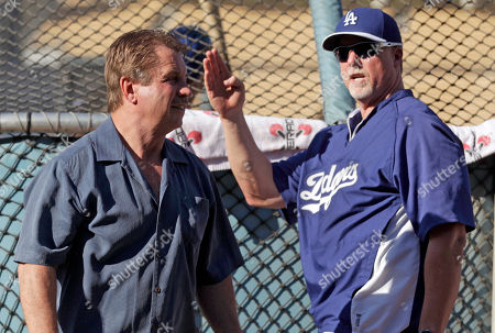Ron Cey, Mark McGwire Former Dodger Ron Cey and current batting coach Mark McGwire chat before a baseball game between the Los Angeles Dodgers and the Washington Nationals in Los Angeles