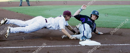 Sam Frost, Ethan Harris Mississippi State's Sam Frost, left, tags out Central Arkansas' Ethan Harris at third base on a fielder's choice in the first inning of their NCAA college baseball regional tournament game in Starkville, Miss