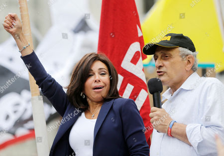 Carl Paladino, Jeanine Pirro Broadcasterer and former Westchester County district attorney Jeanine Pirro, left, and former Republican gubernatorial candidate Carl Paladino, address the audience during a Second Amendment rally, in Albany, N.Y. More than 1,000 demonstrators filled a park outside the Capitol calling for repeal of New York's new gun law