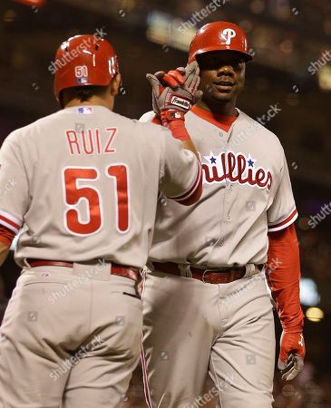 Ryan Howard Philadelphia Phillies' Ryan Howard, right, is congratulated by Carlos Ruiz (51) after Howard hit a home run off San Francisco Giants' Jose Mijares in the ninth inning of a baseball game, in San Francisco