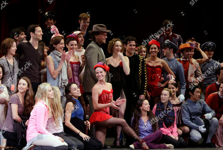 "Mike Piazza, Philip Neal, Lourdes Lopez Former Major League Baseball catcher Mike Piazza, center, wearing brown hat, poses with cast members of the Miami City Ballet during a dress rehearsal of Slaughter on Tenth Avenue, in Miami. Piazza plays a gangster and has a few lines in the company's May 3 production of the ballet George Balanchine choreographed as part of the 1930's musical ""On Your Toes."" Also shown are Philip Neal, stager of the ballet, second from left, center row, and Lourdes Lopez, artistic director of Miami City Ballet, third from left, center"