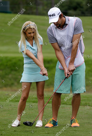 Win McMurry, Michael Phelps Win McMurry, left, of the Golf Channel, coaches the swing of Olympic swimmer Michael Phelps during the TOUR Wives Golf Classic, as part of The Players Championship golf tournament at TPC Sawgrass in Ponte Vedra Beach, Fla