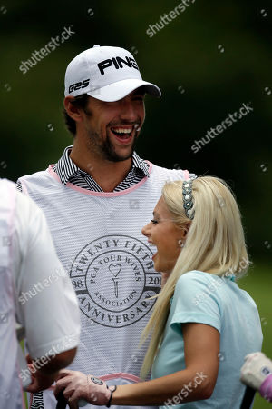 Win McMurry, Michael Phelps Win McMurry of the Golf Channel and Olympic swimmer Michael Phelps participate in the TOUR Wives Golf Classic, as part of The Players Championship golf tournament at TPC Sawgrass in Ponte Vedra Beach, Fla