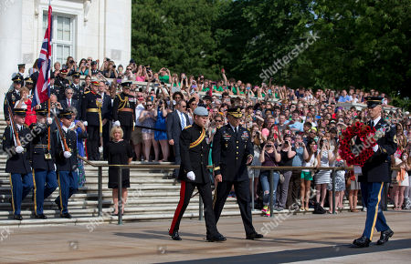 Prince Harry, Michael Linnington Britain's Prince Harry, center left, and Major General Michael Linnington, center right, participate in a wreath laying ceremony at the Tomb of the Unknowns at Arlington National Cemetery in Arlington, Va