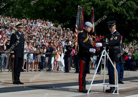 Prince Harry, Michael Linnington England's Prince Harry places a wreath with the help of a member of The Old Guard during a wreath laying ceremony at theTomb of the Unknowns at Arlington National Cemetery in Arlington, Va . Standing left is Major General Michael Linnington