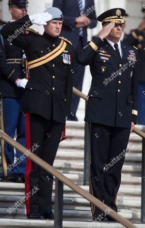 Prince Harry, Michael Linnington Britain's Prince Harry and Major General Michael Linnington, right, salute during a wreath laying ceremony at the Tomb of the Unknowns at Arlington National Cemetery in Arlington, Va