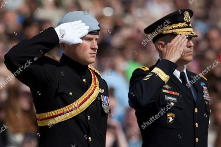 Prince Harry, Michael Linnington Prince Harry and Major General Michael Linnington, right, salute during a wreath laying ceremony at the Tomb of the Unknowns at Arlington National Cemetery in Arlington, Va