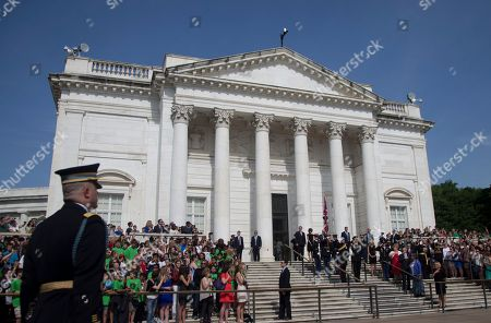 Prince Harry, Michael Linnington England's Prince Harry and Major General Michael Linnington, right, pause on the steps during a wreath laying ceremony at the Tomb of the Unknowns at Arlington National Cemetery in Arlington, Va