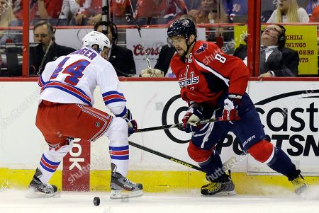 Stock Picture of Steve Eminger, Alex Ovechkin New York Rangers defenseman Steve Eminger (44) guards Washington Capitals left wing Alex Ovechkin (8), from Russia, in the first period of Game 5 first-round NHL Stanley Cup playoff hockey series, in Washington