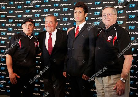Bob Arum, Ryota Murata, Ismael Salas, Miguel Diaz Bob Arum, Ryota Murata, center left and right, are joined by Murata's trainers Ismael Salas, left, and Miguel Diaz at a news conference to announce professional boxing debut of 2012 Japanese middleweight Olympic Gold Medalist Ryota Murata, in Beverly Hills, Calif