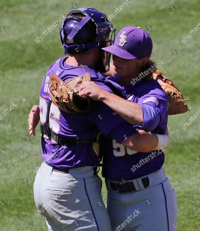 Stock Image of LSU's Chris Cotton, right, gets a hug by LSU's Ty Ross at the end of their Southeastern Conference Tournament baseball game at the Hoover Met in Hoover, Ala., . LSU beat Arkansas 3-1 to advance to the championship game