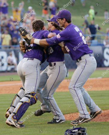 Stock Picture of LSU's Chris Cotton, center, celebrates withTy Ross, left, and first baseman Tyler Moore after a win over Vanderbilt in the Southeastern Conference NCAA college baseball tournament championship game at the Hoover Met in Hoover, Ala., . LSU defeated Vanderbilt 5-4 in 11 innings