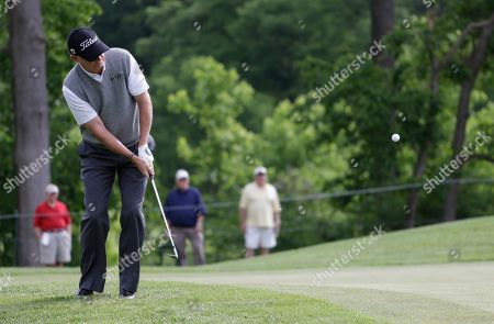 Roger Chapman Defending champion Roger Chapman, of England, chips onto the first green during the first round of the 74th Senior PGA Championship golf tournament at Bellerive Country Club, in St. Louis
