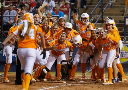 Stock Photo of Madison Shipman Tennessee players wait at home plate for Madison Shipman (44) following her home run against Oklahoma in the 11th inning of the first game of the best-of-three Women's College World Series NCAA softball championship series in Oklahoma City. Oklahoma won 5-3 in 12 innings. Tennessee's decision to eliminate the Lady Volunteers nickname in all sports but basketball is the latest move in a nationwide trend as schools move away from separate team monikers for men and women. The difference this time is the level of protests accompanying the move