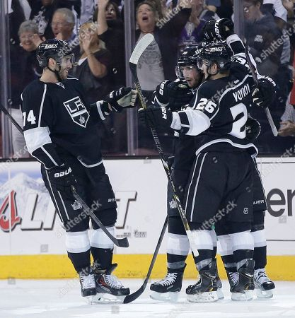 Slava Voynov, Dwight King, Jeff Carter Los Angeles Kings' Slava Voynov (26) celebrates his first-period goal against the San Jose Sharks with teammates Dwight King, left, and Jeff Carter in Game 1 of a second-round NHL hockey Stanley Cup playoff series, in Los Angeles