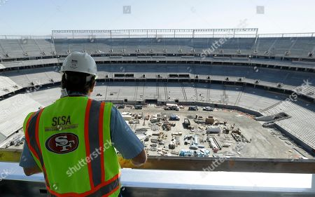 Stock Picture of San Francisco 49ers project executive Jack Hill looks over the field at the new San Francisco 49ers football stadium in Santa Clara, Calif., . Goodbye grungy, cold Candlestick Park. Hello high tech, glittering, Levi's Stadium. Fifty-four years after $32 million Candlestick Park opened, the 49ers are building a new $1.2 billion showcase of a stadium which is almost twice as big, wired to the hilt, and opening its doors just in time to host Super Bowl 50 in the heart of the Silicon Valley