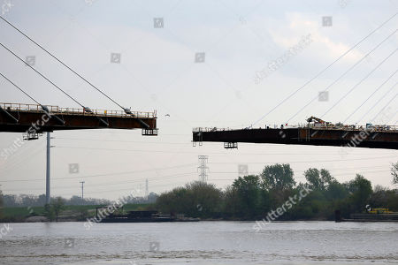 A bridge under construction across the Mississippi River from Missouri to Illinois is seen, in St. Louis. The Illinois House has approved a resolution naming the new bridge the Veterans Memorial Bridge but Missouri lawmakers and key members of Congress from the two states favor dubbing it after late St. Louis Cardinals legend Stan Musial