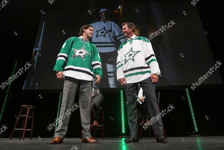 Jamie Benn, Mike Modano Former Dallas Stars Mike Modano, right, and current left wing Jamie Benn look at each other after they walked onto the stage introducing the team's new logo on their hockey jerseys in Dallas Tuesday