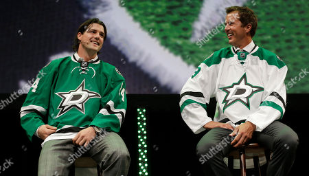 Jamie Benn, Mike Modano Former Dallas Stars Mike Modano, right, and current left wing Jamie Benn wear the team's new logo on hockey jerseys during an unveiling of the new design in Dallas Tuesday