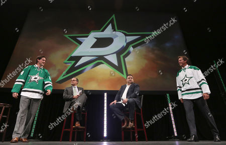 Jamie Benn, Mike Modano, Daryl Reaugh, Tom Gaglardi Former Dallas Stars Mike Modano, right, and current left wing Jamie Benn, left, walk on stage in hockey jerseys unveiling the new team design with broadcaster Daryl Reaugh, center left, and owner Tom Gaglardi looking on in Dallas Tuesday