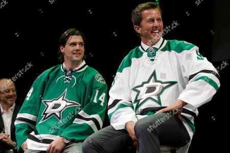 Jamie Benn, Mike Modano Former Dallas Stars Mike Modano, right, and current left wing Jamie Benn smile as they wear the team's new logo on hockey jerseys during an unveiling of the new design in Dallas Tuesday