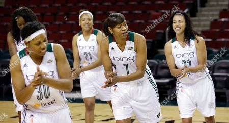 Tanisha Wright, Tianna Hawkins, Tina Thompson, Alysha Clark Seattle Storm players Tanisha Wright (30), Tianna Hawkins (21), Tina Thompson (7) and Alysha Clark practice a dance move during a video session during the team's media day in Seattle. The Storm opens their regular season Sunday, May 26, at Los Angeles