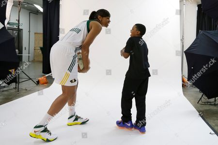 Tina Thompson Seattle Storm's Tina Thompson laughs with her son, Dyllan Thompson Jones, 8, after the boy snuck up behind Thompson while she was being photographed during the team's media day in Seattle. The Storm opens their regular season Sunday, May 26, at Los Angeles