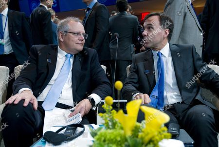 Scott Morrison, Bill Morneau Australia's Treasurer Scott Morrison, left, speaks with Canada's Finance Minister Bill Morneau during the International Monetary and Financial Committee (IMFC) conference at World Bank/IMF Annual Meetings at IMF headquarters in Washington
