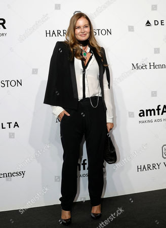 Eva Cavalli poses for photographers as she arrives for the amfAR charity dinner during the fashion week in Milan, Italy