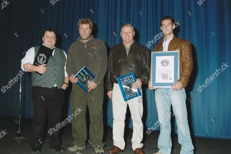 Editor in Chief of the Guiness Book of World Records Craig Glenday, special effects team members Stephen Lewis and Richard Todd and James Bond's stunt double Adam Kirley with a certificate for the Guinness World Record for the most 'cannon rolls' in a car set during the filming of the latest Bond movie 'Casino Royale' on the 15th July 2006.