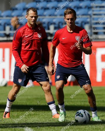 Brad Davis, Stuart Holden Brad Davis, left, and Stuart Holden, right, kick the ball at the start of a U.S. national soccer team practice, in Seattle. The U.S. will face Panama on Tuesday, June 11, 2013, for a World Cup qualifier soccer match