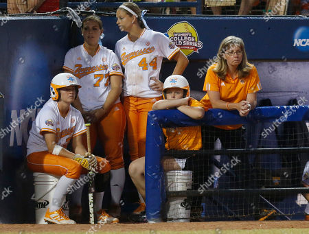 Karen Weekly, Kat Dotson, Cheyanne Tarango, Madison Shipman Tennessee co-head coach Karen Weekly, right, and players Kat Dotson, left, Cheyanne Tarango (77) and Madison Shipman (44) watch from the dugout in the sixth inning of the second game of the best of three Women's College World Series NCAA softball championship series in Oklahoma City, . Oklahoma won the game 4-0 and the best of three series in two games