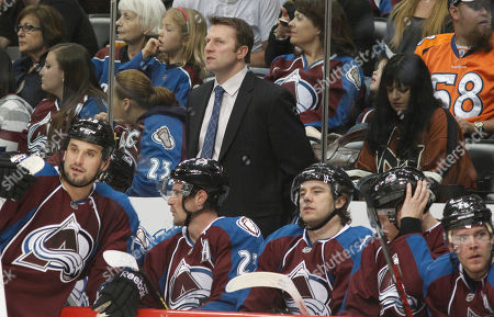 Joe Sacco Colorado Avalanche head coach Joe Sacco, back, looks on as his players take a break during a time out against the Minnesota Wild in the second period of an NHL hockey game in Denver on