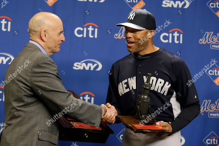 Salvatore Cassano, Mariano Rivera New York Yankees relief pitcher Mariano Rivera, right, receives a fire call box plaque plaque and fire hose nozzle from New York City Fire Commissioner Sal Cassano, left, before an interleague baseball game against the New York Mets at Citi Field in New York
