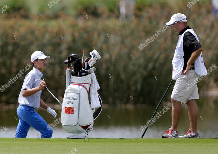 Guan Tianlang Guan Tianlang, 14, of China, choses his club as he prepares to hit out of a bunker on the 18th hole during the third round of the PGA Zurich Classic golf tournament at TPC Louisiana in Avondale, La