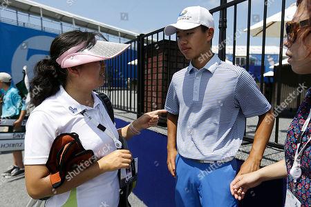 Guan Tianlang, Liu Hongyu Fourteen year old Guan Tianlang, of China, talks with his mother, Liu Hongyu, left, after finishing the third round of the PGA Zurich Classic golf tournament at TPC Louisiana in Avondale, La