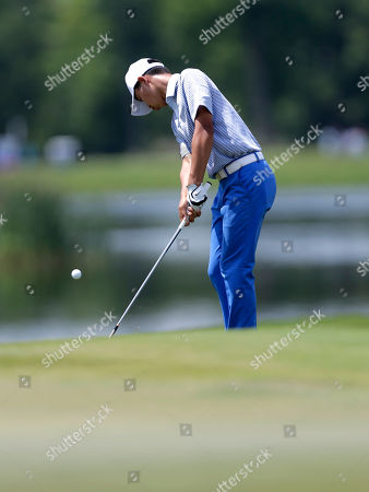 Guan Tianlang Fourteen year old Guan Tianlang, of China, chips onto the 18th green during the third round of the PGA Zurich Classic golf tournament at TPC Louisiana in Avondale, La