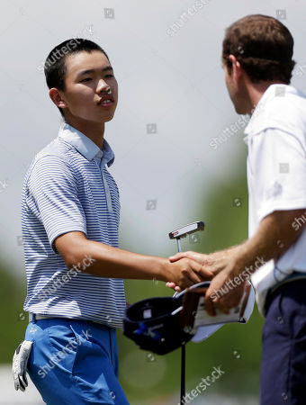 Guan Tianlang, Lee Williams Guan Tianlang, 14, of China, shakes hands with Lee WIlliams, right, after they finished the third round of the PGA Zurich Classic golf tournament at TPC Louisiana in Avondale, La