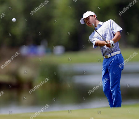 Guan Tianlang Guan Tianlang, 14, of China, chips to the 18th green during the third round of the PGA Zurich Classic golf tournament at TPC Louisiana in Avondale, La