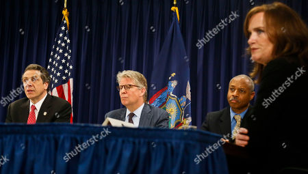 Gov. Andrew Cuomo, far left, with members of the District Attorney Association including, Manhattan District Attorney Cyrus Vance, second from left, Bronx D.A. Robert Johnson, second from right, and Nassau County D.A. Kathleen Rice, far right, hold a news conference on in New York. Gov. Cuomo proposed legislation to give prosecutors more power to combat public corruption and will for the first time require public officials to report corrupt actions by their colleagues