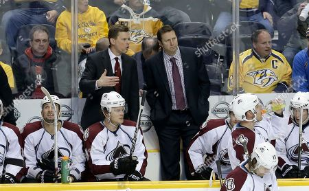 Tim Army, Joe Sacco Colorado Avalanche head coach Joe Sacco, standing at right, talks with assistant coach Tim Army, left, in the third period of an NHL hockey game against the Nashville Predators, in Nashville, Tenn. The Predators won 3-1