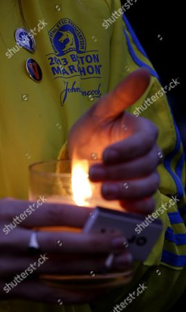 Lauren Jones Lauren Jones, 30, of Boston, who volunteered during the Boston Marathon and was three blocks from the site of the explosions, holds a candle during a vigil for the victims at Boston Common
