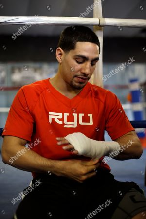 Danny Garcia Boxer Danny Garcia tapes his hands during a workout session for the media, in Philadelphia. Garcia is scheduled to fight Zab Judah on April 27 in New York