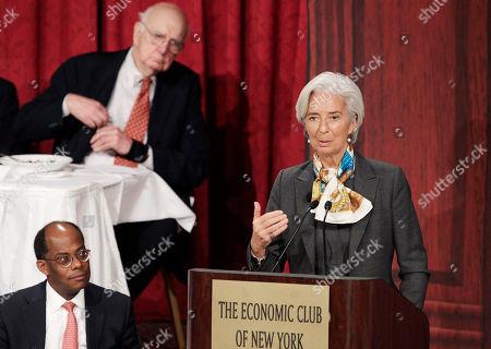 Christine Lagarde, Roger Ferguson, Jr., Paul Volcker Christine Lagarde, right, managing director of the International Monetary Fund, speaks at the Economic Club of New York, . Listening to her are Roger Ferguson, Jr., left, chairman of the club, and Paul Volcker, former chairman of the Federal Reserve Board