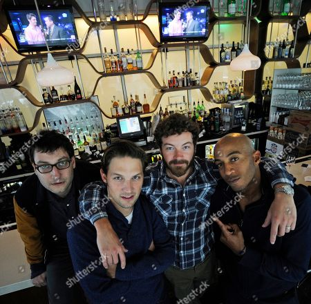 Adam Busch, Michael Cassidy, Danny Masterson and James Lesure Men at Work actors Adam Busch, Michael Cassidy, Danny Masterson and James Lesure, from left, pose for a photo, in Atlanta. Men at Work will be in its second season and premiers April 4 on TBS