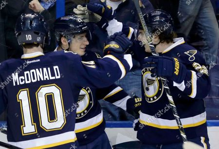 Alexander Steen, Kevin Shattenkirk, Andy McDonald St. Louis Blues' Alexander Steen, center, is congratulated by teammates Kevin Shattenkirk, right, and Andy McDonald after scoring during the second period of an NHL hockey game against the Calgary Flames, in St. Louis