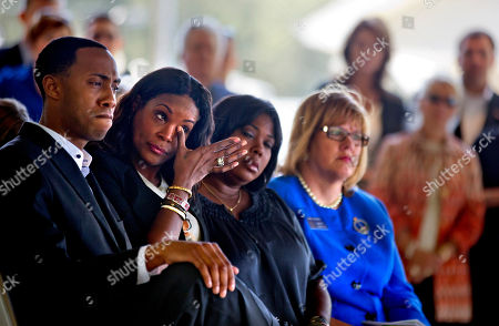 Tameka Foster Tameka Foster, second from left, mother of Kile Glover, the stepson of R&B artist Usher who died in a boating accident last year, wipes a tear during a ceremony for the signing of a comprehensive boating safety bill, in Buford, Ga. The bill, signed Tuesday at an event at Lake Lanier, honors the memory of Jake and Griffin Prince as well as Kile Glover who all three died in accidents on the lake last summer. The bill lowers the blood-alcohol limit for boaters to .08 to match the driving limit. The bill also requires a boater safety education course for those operating motorized vessels that were born since Jan. 1, 1998