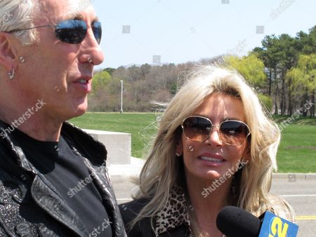 Stock Image of Dee Snider, Suzette Snider Dee Snider, lead singer of the rock band Twisted Sister, stands with his wife Suzette Snider outside U.S. District Court in Central Islip, N.Y., on . The couple attended the sentencing of a man convicted of conspiracy and murder in the deaths of Suzette Snider's brother and two other men