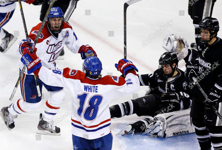 A.J. White, Josh Holmstrom, Nick Saracino, John Gilmour Massachusetts-Lowell's A.J. White (18) celebrates his goal with teammate Josh Holmstrom (12) beside Providence's Nick Saracino (18) and John Gilmour, right, in the third period of an NCAA college hockey game in the semifinals of the Hockey East tournament in Boston, . UMass-Lowell won 2-1