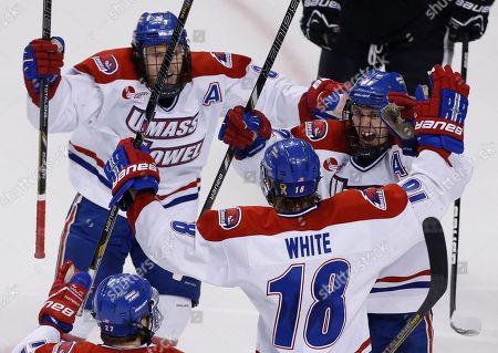 Chad Ruhwedel, Josh Holmstrom, A.J. White UMASS Lowell's A.J. White (18) celebrates his goal with teammates Josh Holmstrom, right, and Chad Ruhwedel (3) in the third period of an NCAA Hockey East semi-final game against Providence in Boston, . UMASS Lowell won 2-1